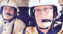 Photo of regional field manager and fire management officer in helicopter.